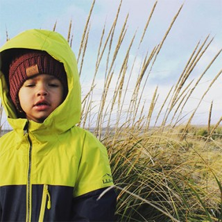 Photo of a boy out in a marsh.