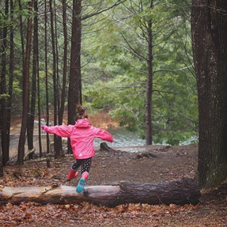 Image of a child in the woods hiking.