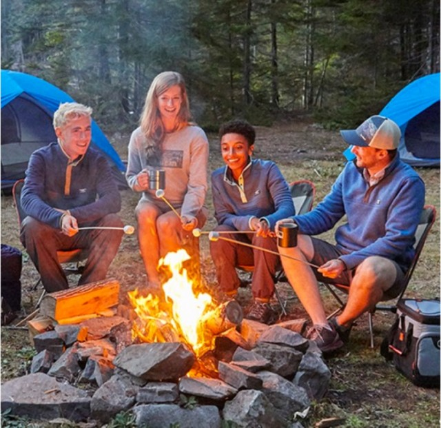 Group of people around a campfire.