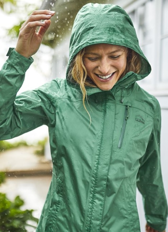 Photo of a woman in a rain coat.