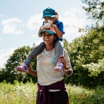 woman with child on shoulders
