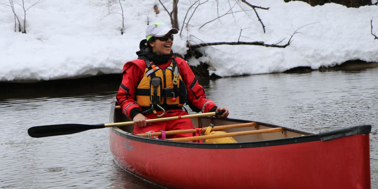 Maine Guide and L.L.Bean Outdoor Discovery instructor Sarah Quaintance, paddling a canoe in winter.