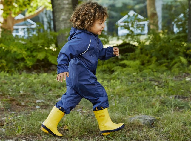 Photo of a child in rain gear.