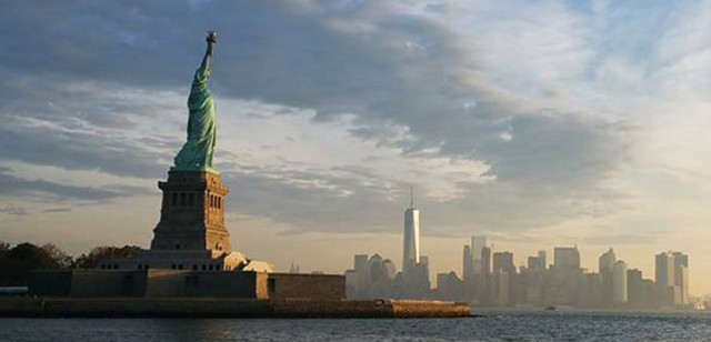 New York skyline and the Statue of Liberty.