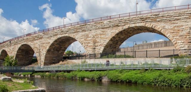 A stone bridge and a river.