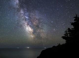 nighty sky above the ocean