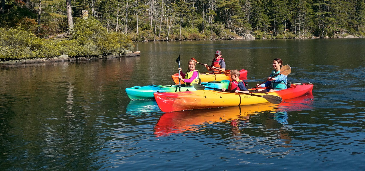 A family kayaking on a lake.