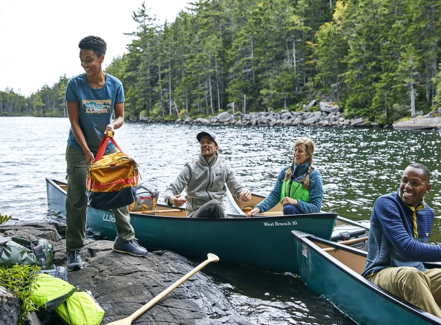 4 friends canoe camping