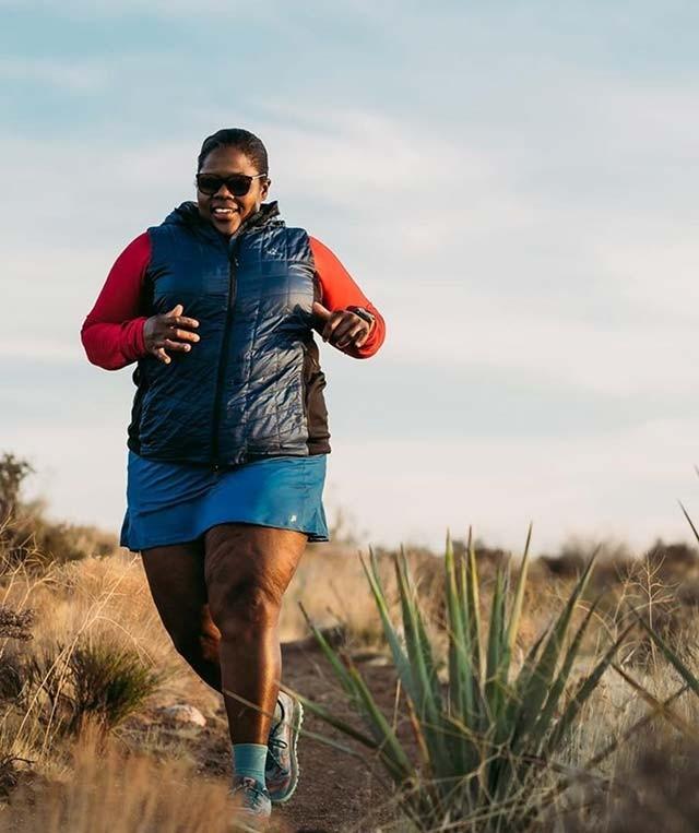 Mirna Valerio running in the desert.