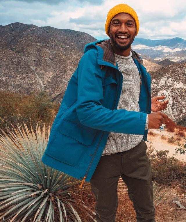 Joshua Walker smiling in a beautiful mountain setting.