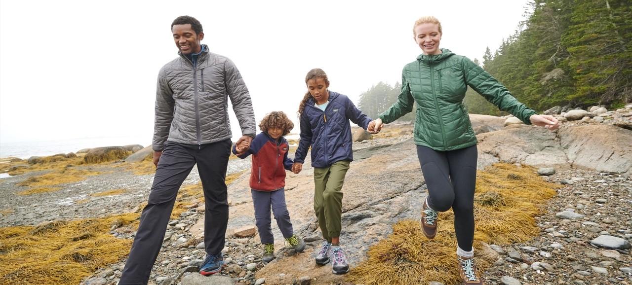 Family walking along the coast on a foggy day.