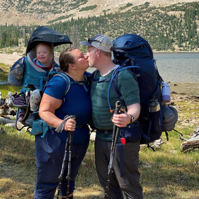 Melody Forsyth and her husband sharing a kiss on the trail.