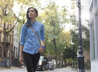 Woman walking down city street