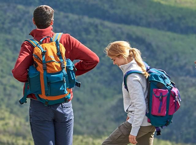 Two hikers wearing backpacks.