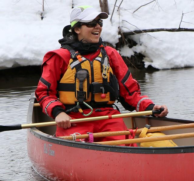 Susan Quaintance paddling a canoe in winter