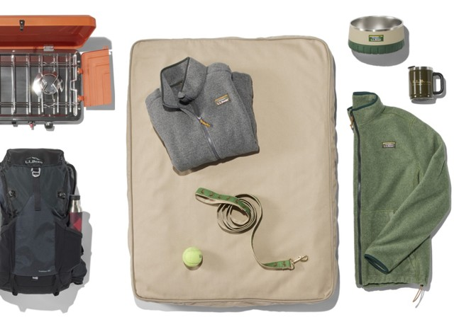 An assortment of holiday gifts including acamp stove, a backpack, a dog bed, a fleece jacket and an insulated mug.