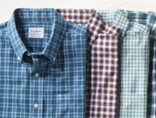 Close-up of 4 plaid shirts.