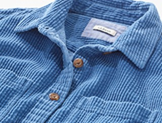 Close-up of a corduroy button-up shirt.