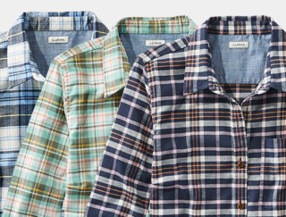 Close-up of 3 plaid shirts.