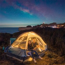 Person in tent outside