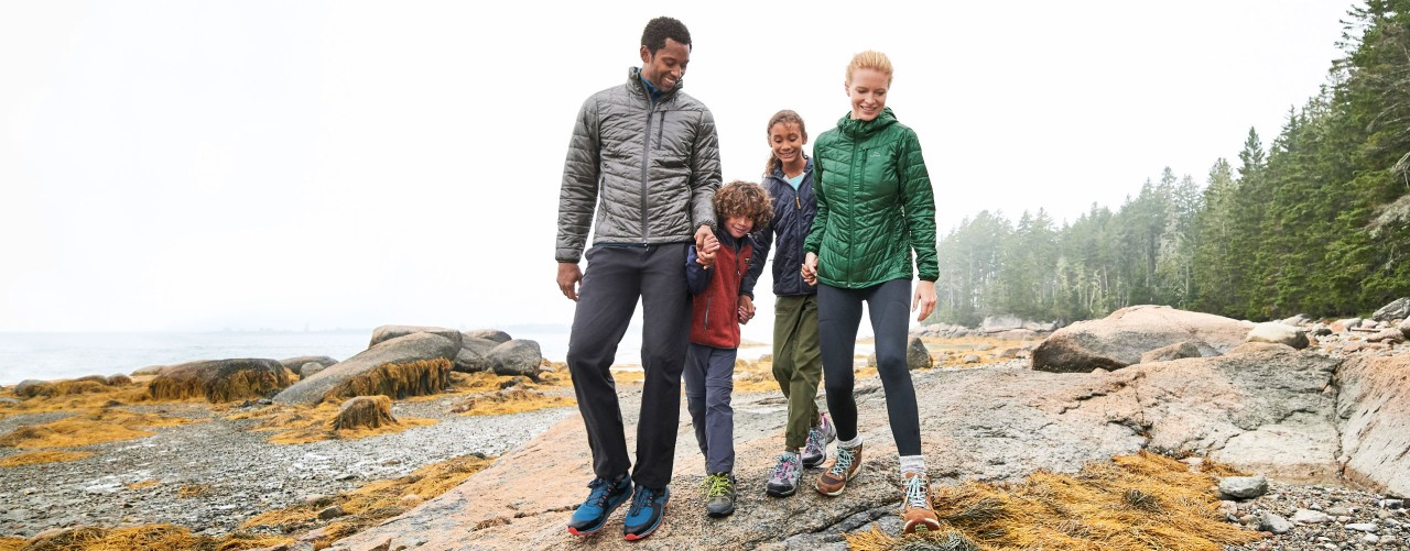 Family walking on the rocks