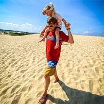Father and daughter walking on the beach