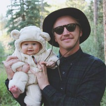Father holding his baby daughter outside