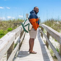 Man on a beach boardwalk.