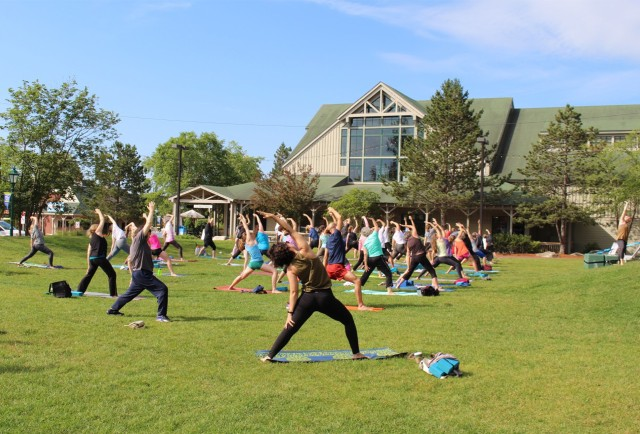 A yoga class in Discovery Park at the flagship store.