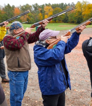Group of men clay shooting