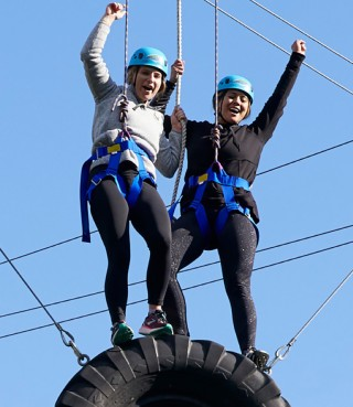 Team on the top of a ropes course