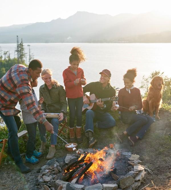 Family around a campfire.