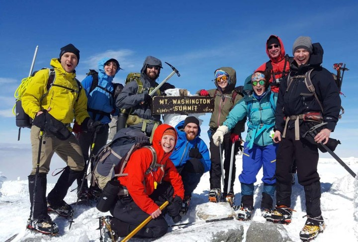 L.L.Bean Outing Club members summiting Mount Washington in the winter.