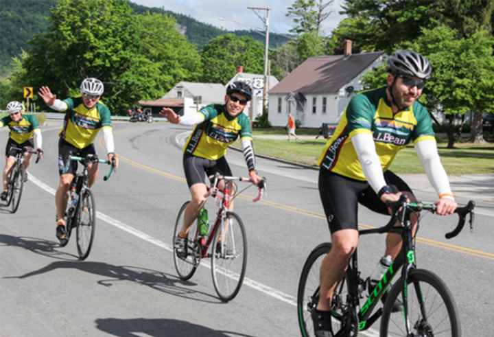 A photo of L.L.Bean employees biking in the annual Trek Across Maine.