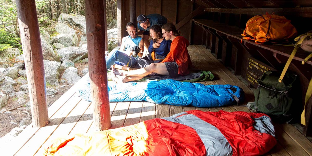 Group of campers in a lean-to shelter.