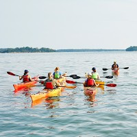 Group of people kayaking.