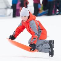 A boy sledding.