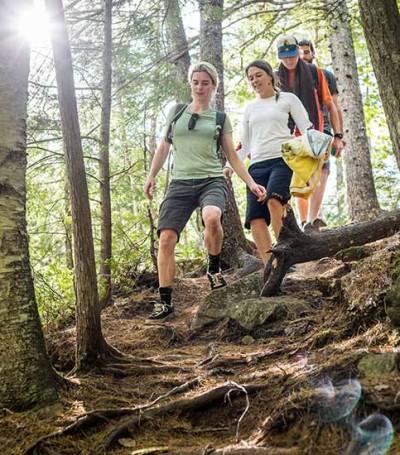 People walking down a trail