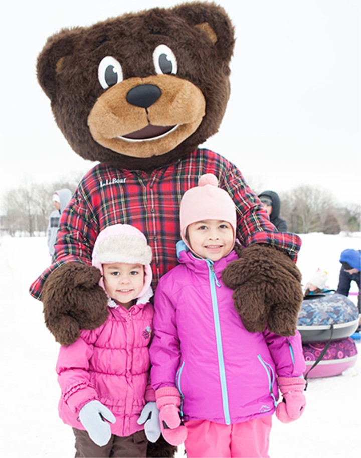 L.L. Bear with kids outside in snow.