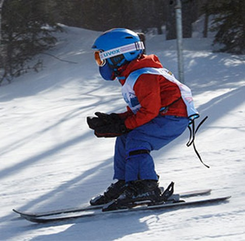 Little kid skiing