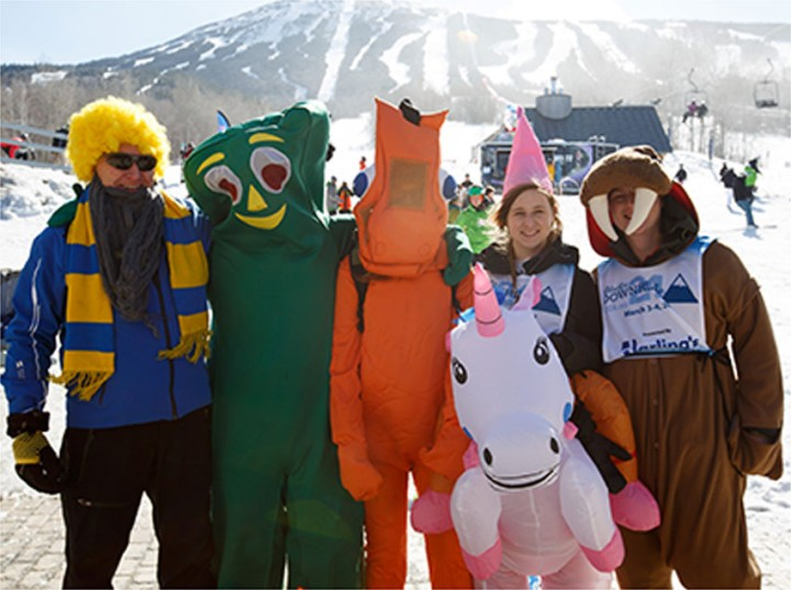 Mascots outside for winter fun including Gumby, walrus and unicorn.