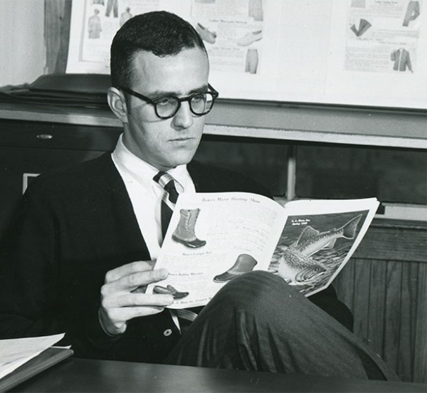 Leon Gorman reading an L.L.Bean catalog.