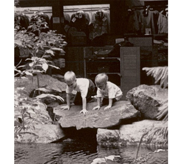Boys look into the trout pond at the Freeport L.L.Bean store.