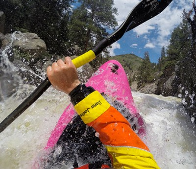 A kayaker in the rapids.
