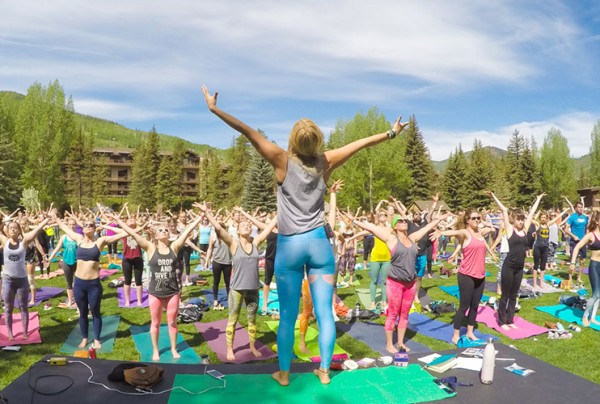 Yoga in a beautiful mountain setting.
