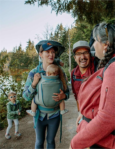 Man, woman and children hiking.