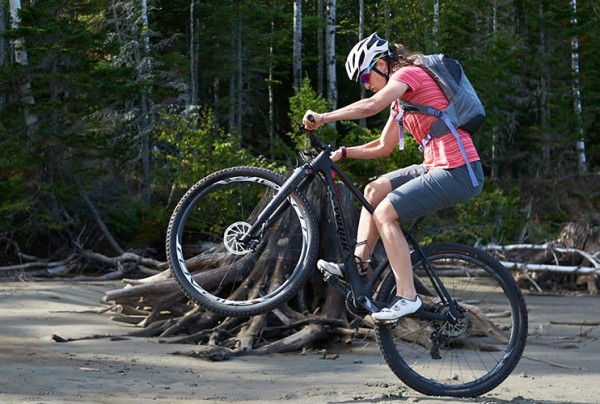 National champion Lea Davison practicing her biking skills in the woods.
