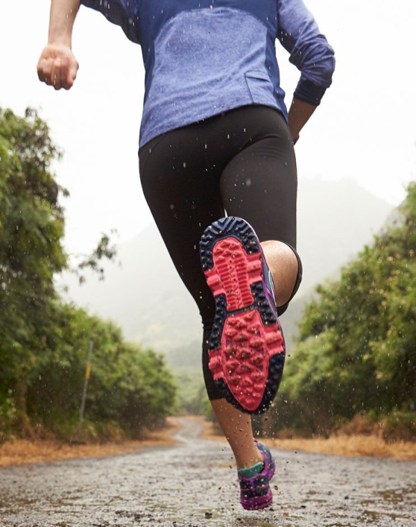 L.L.Bean partner athlete Lea Davison running on a trail.