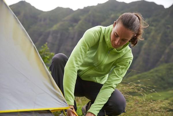 Lea Davison setting up an L.L.Bean tent in the mountains.