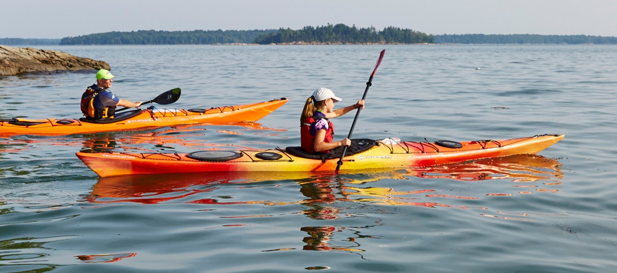 Two people kayaking during an Outdoor Discovery Schools event.